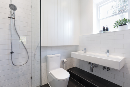 tiling: Small ensuite bathroom with white tiling laid in a brick pattern