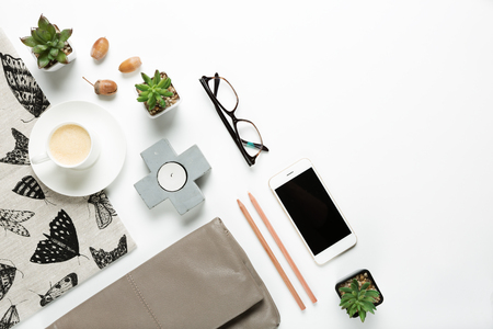 Styled collection of home objects and womens fashion accessories flat lay overhead