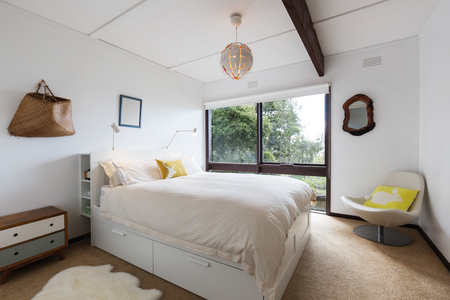 Retro styled guest bedroom in a 70s beach house shack