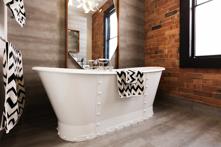 decor residential: Close up of white freestanding bat tub in vintage interior styled bathroom