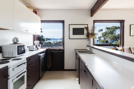 70's: Older style retro 70s kitchen in Australian beach house with a view