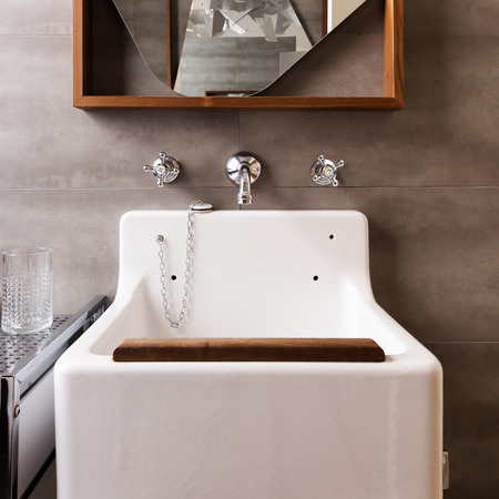 en suite: Close up of a vintage style bathroom sink with wood detail Stock Photo