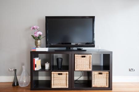 Modern Apartment Living Room With Tv On Buffet And Bi Fold Door - Buffet tv