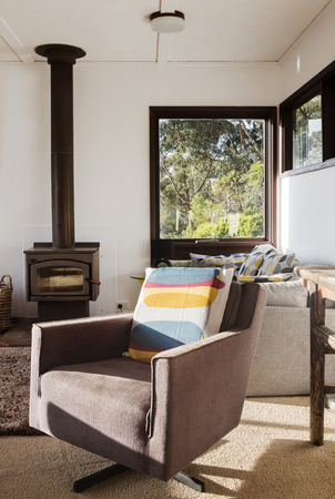 room accents: Classic vintage retro lounge recliner armchair in 70s beach house