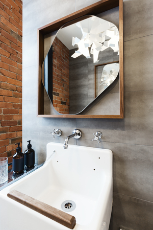 ensuite: Close up of vintage style bathroom vanity in renovated warehouse apartment Stock Photo