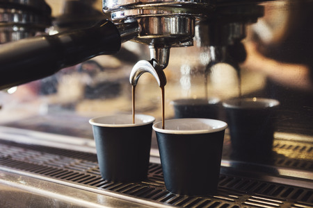 Industrial coffee machine making two cups of espresso horizontal