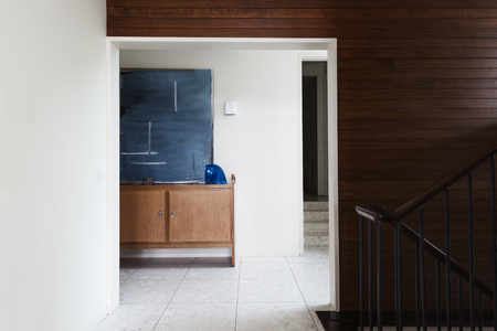 mid century: Wood panel wall detail and entry foyer in mid century modern Australian home Stock Photo