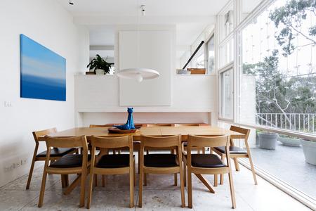 mid century: Beautiful scandinavian style dining room in mid century modern Australian home