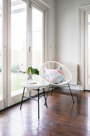 styled interior: White string style occasional chair and matching side table in luxury home Stock Photo