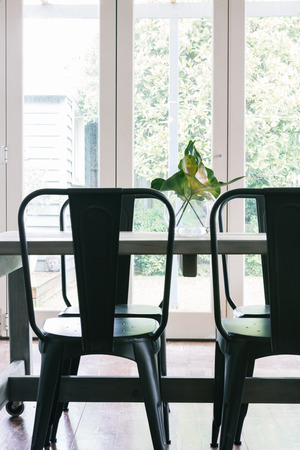castors: Close up vertical of black metal industrial styled dining table