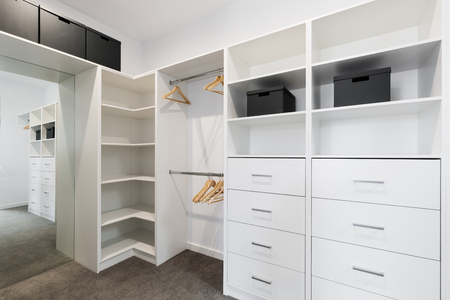 Large walk in wardrobe cabinetry detail in new home Stock Photo - 75761264