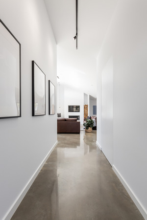 Bright white contemporary new home entrance hall to living room