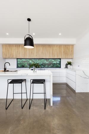 Luxury kitchen with carrera marble waterfall island bench Standard-Bild
