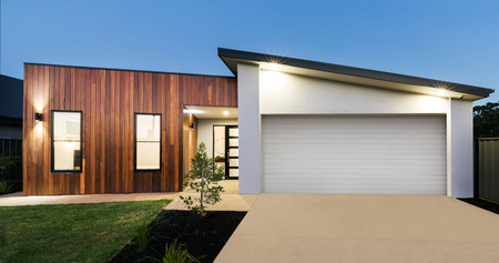 Contemporary new Australian home lighting at dusk Reklamní fotografie - 77027077