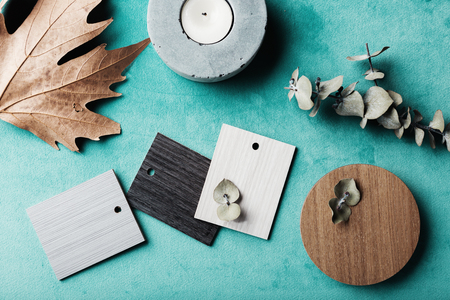 Group of muted wood and laminte swatches flat lay
