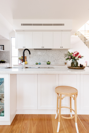 Hamptons styled kitchen with marble herringbone splash back