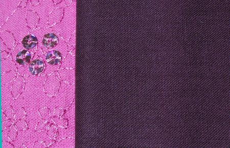 A close up shot of decorated pink cotton fabric and plain brown cotton fabric