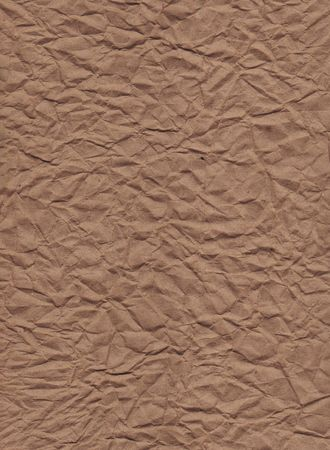 A vertical view of wrinkled brown kraft paper