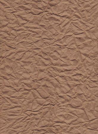 A vertical view of wrinkled brown kraft paper