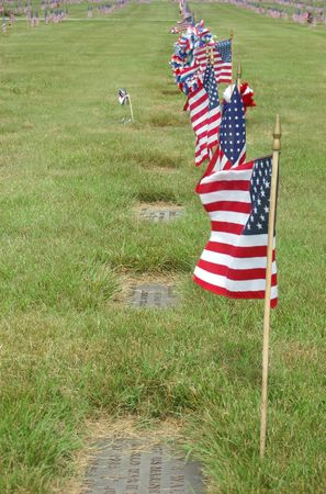 Memorial Day flags on each grave in a Veteran's cemetery. Stock Photo