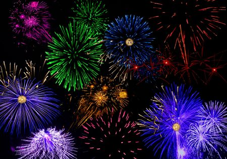 Many colorful fireworks in a black sky. Stock Photo