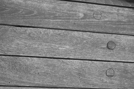 A Grayscale Image of An Old Wooden Ship Detail