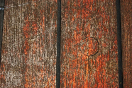 A close up of an old wooden boat with scratches and faded paint Stock Photo