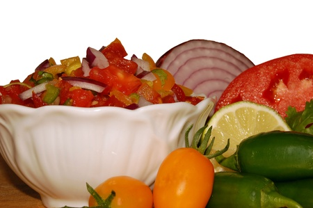 Fresh salsa over white surrounded by ingredients