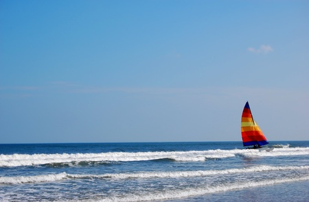 A colorful catamaran in the ocean surf Banque d'images