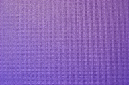 A close up shot of textured purple paper
