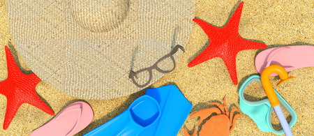 green crab: starfish, hat , slippers and flippers lying on sand