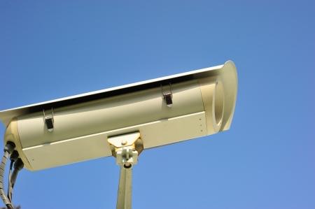 CCTV or security camera against blue sky background