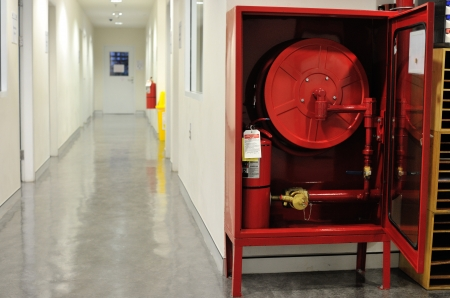 extinguisher: Fire hose cabinet installed in the building