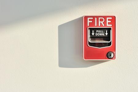glass break: Fire alarm switch on wall Stock Photo