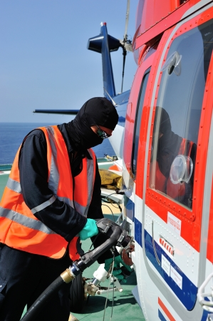 Helideck crew is refueling the helicopter at offshore platform in the Gulf of Thailand Editorial