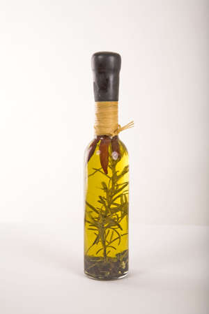 Bottle of oil and herbs
