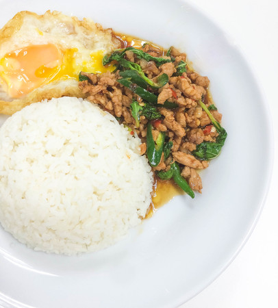 Fired Stir Basil and Minced Pork and Fried Egg has ready to served. Stock Photo