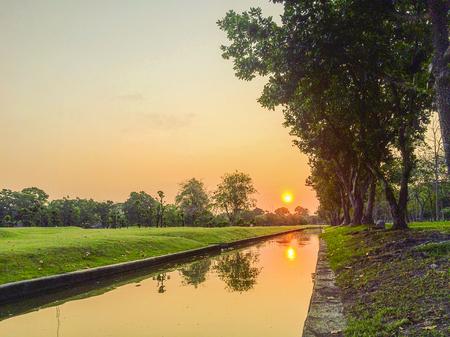thialand: Sunrise on the river in Phutthamonthon Nakhon Pathom Province of Thailand, west of Bangkok. Stock Photo