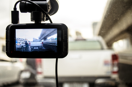 A camera in car has on and recording for the traffic jam in the morning.