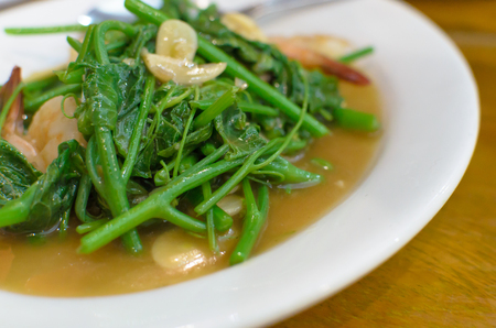 Stir-Fried Chinese Water Cress with Shrimp and Garlic.