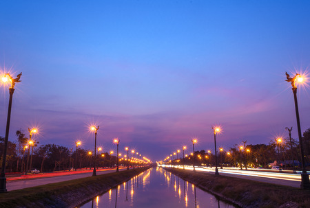 Long exposure sunset over a highway Utthayan Road in Bangkok Thailand. Stock Photo