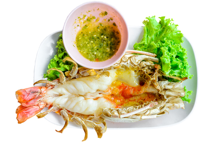 Grilled fresh big shrimp, river prawn thai style with spicy sauce isolated on white background. Stock Photo