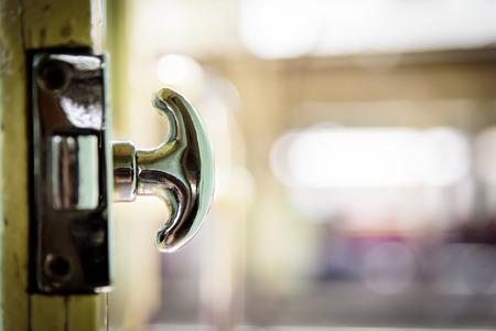 Close-up view of the old door passenger train and door handle.