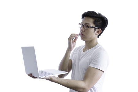 Asian handsome man with white shirt has wake up and  sleepy with tooth brush and working by holding laptop before going to start the work in the morning isolated on white background