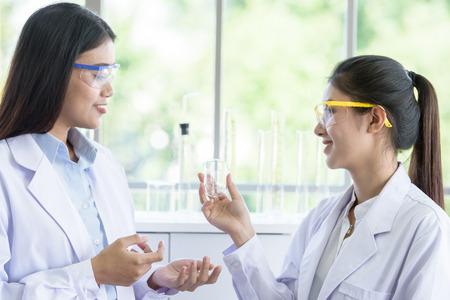 Asian young female working and research scientist together.