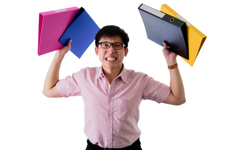 Asian young businessman has standing and holding many documents and folders with upset on isolated on wihte background.