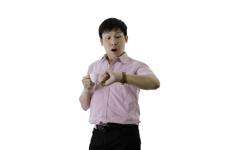 Asian young businessman has standing and check working time with shocked on isolated on wihte background.