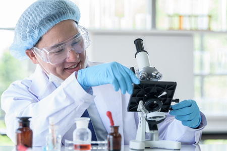 Asian man scientist researching  and learning in a laboratory. Stock Photo