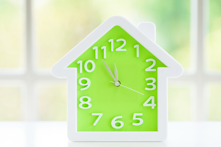 The clock model with before lunch time and window background in the morning. Stock Photo
