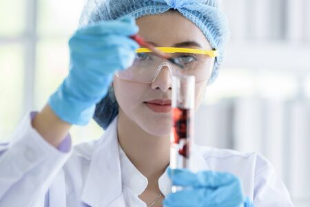 Asian young girl student scientist researching  and learning in a laboratory.
